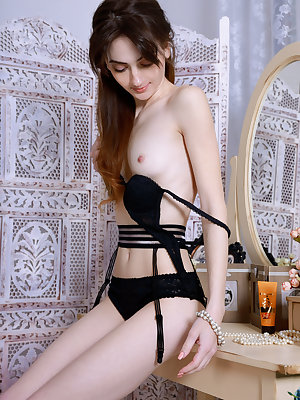 Very skinny brunette Mira removes her lingerie to reveal small tits & spread