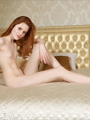 Thin redhead with tiny titties showcases her bald vagina atop her bed