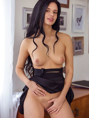 Drop-dead gorgeous brunette model Carmen Summer strips and touches her pussy