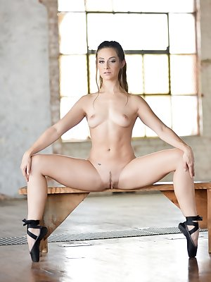 Slender dancer doffs her bodysuit to workout in the nude stretching wide open