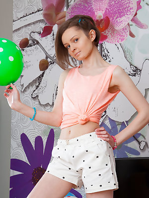 Thin teen girl models in over the knee socks with polka dot balloons