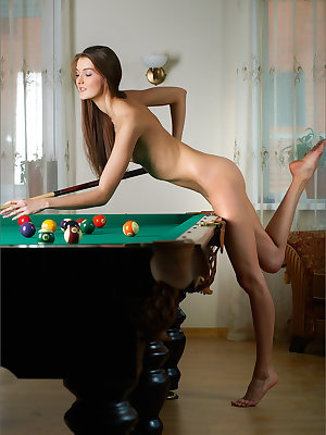 Pretty skinny teen disrobes to pose naked showing small tits on the pool table