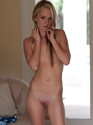 Blonde with small breasts Sara undresses and poses butt naked