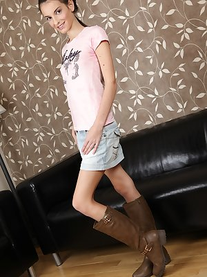 Skinny teen girl with tiny tits parts her labia lips wearing winter boots