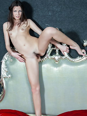 Lingerie clad Quinn A spreading her long slender legs to show a hairy beaver