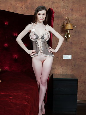 Young skinny Emily Bloom in hot lingerie spreading her thin legs to show pink