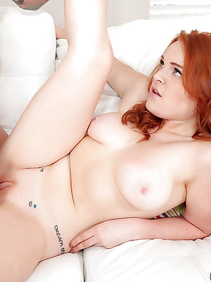 Busty redheaded amateur Ginger Rose and her nice natural juggs riding cock