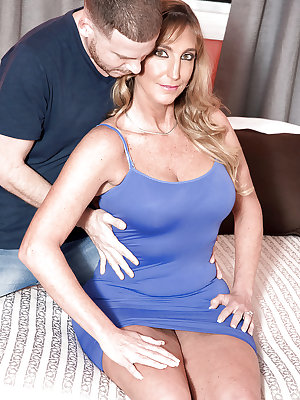 Busty over 40 cougar with shaved pussy and big cock engage in hardcore sex