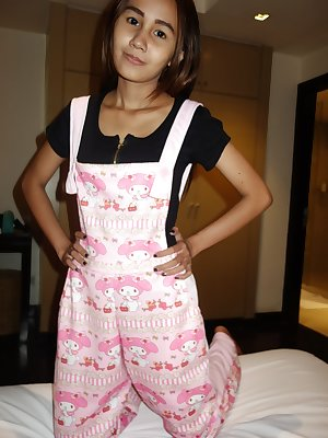 Slim Thai girl Puy is convinced to let her small boobs loose from her overalls