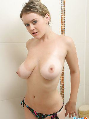 Sexy Brook Little doffs her bikini to pour soap on her big tits in the shower