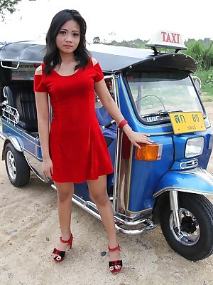 Petite Filipina girl takes off her red dress before pulling down her panties