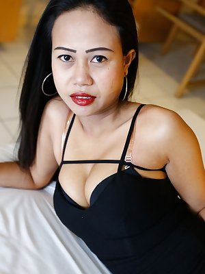 Slim Thai female removes her little black dress for her first nude poses