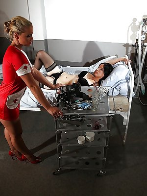 Kathia Nobili in doctor's uniform is dominating her slave Lexy Little