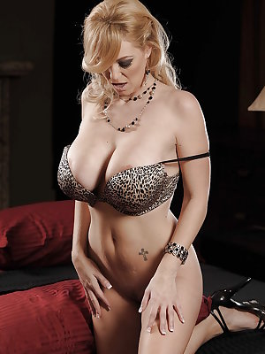 Busty MILF Charlee Chase taking off her black dress and lingerie