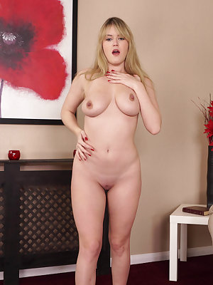 Amateur model Brook Little strips off her bra and panties to pose naked
