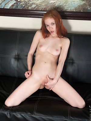 Natural redhead amateur Dolly Little strips off jeans and white underwear