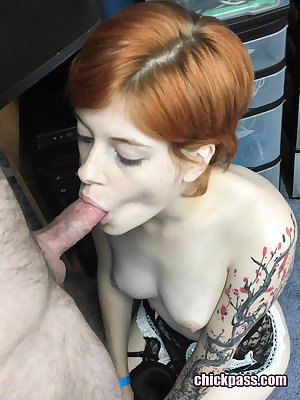 Tattooed redhead Ava Little sucks on a cock for the first time