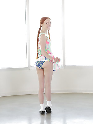 Young redhead Dolly Little revealing shaved pussy in pigtails and socks