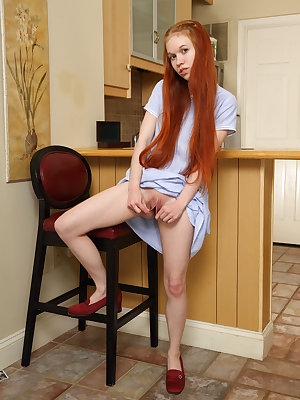 Cute amateur Dolly Little smiles broadly as she inserts kitchen utensils