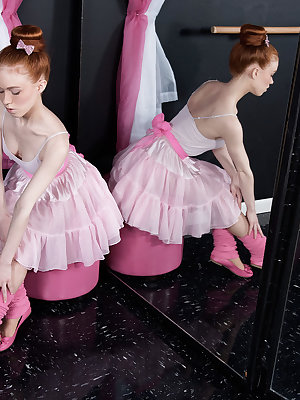 Redhead ballerina Dolly Little strips down to pink leg warmers and slippers