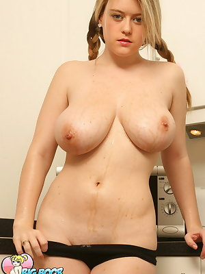 Cute blonde Brooke Little flaunts her naked oiled big tits in the kitchen