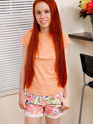 Cute redhead Dolly Little undresses on a stool prior to spreading her pussy