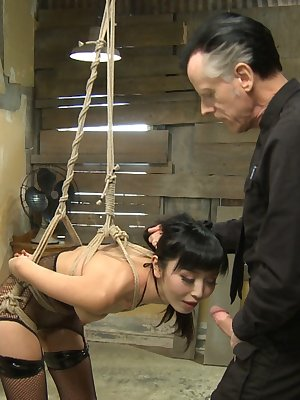 Japanese beauty Marica Hase is suspended by rope before sucking cock