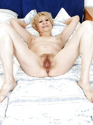 Dirty granny Kati Bell with a hairy pussy is masturbating