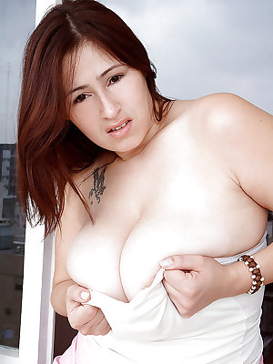 Fat lady demonstrates puffy boobs and little bush on her heated cunt