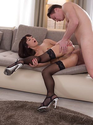 Angie Moon gets her shaved pussy fucked before she swallows his cum