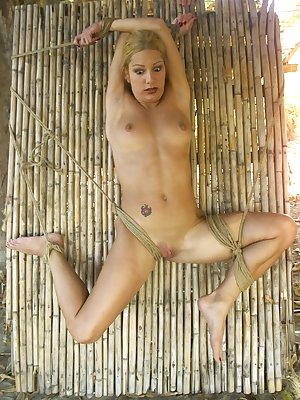 Jenni Lee enjoys some humiliating bondage while being penetrated by a dildo