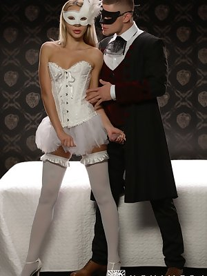Blonde chick and her man friend have sex attired in masquerade masks