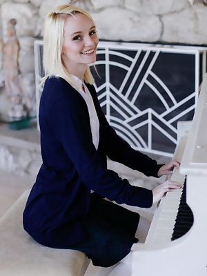Innocent blonde Sammie Daniels is playing piano during undressing