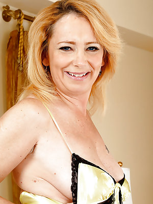 Mature one Brandie Sweet is playing with her big boobies and anal gape