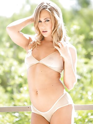 Blonde super babe Carter Cruise posing outdoors in bra and underwear