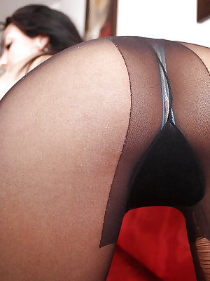 Latina brunette babe Adriana Vega shows her ass in black pantyhose