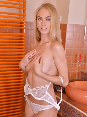 Blue-eyed honey Nancy A adores expensive lingerie and her small sex toy