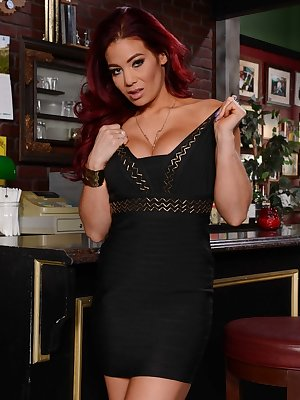 Redhead MILF Ryder Skye showing off her big juggs and pink holes at the bar