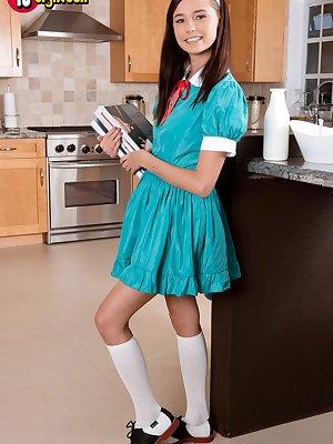 Teen college girl Carolina Sweets takes off uniform to show cunny in kitchen