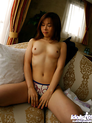 Naughty asian babe slowly stripping off all of her clothes