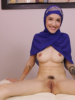 Muslim female reveals her natural tits and trimmed muff while jerking a cock