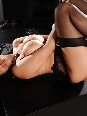 Busty assistant Vanilla Deville shows off her assets as she strips down naked