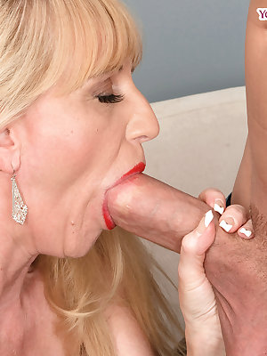 Big titted mature woman Kay Kummingz sucks off her boy toy's huge cock