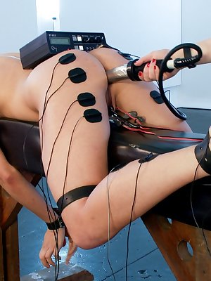 Dahlia Sky and Aiden Starr enjoy some electrical play and other BDSM toys