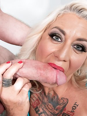 Tattooed mature lady Amelia Mack gets butt fucked by her toy boy