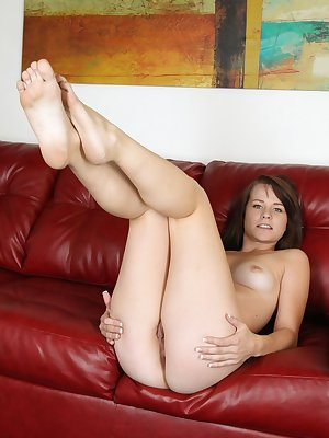 Teen Alexis Tyler undresses and picks up a small toy to play a little bit