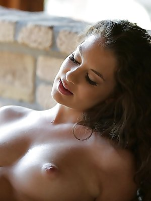 Hot solo babe Angelina Brill playing with her nice all natural breasts