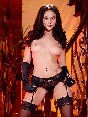 Solo model Ariana Marie is already for Halloween in a witches outfit