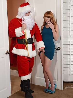 Natural redhead Marie McCray gets lubed up and banged by Santa Claus
