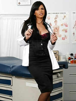 Dark haired doctor Shy Love uncovers her big tits as she strips in exam room